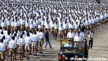 epa03526446 Members of the Rashtriya Swayamsevak Sangh (RSS), or National Volunteers Organization as in English, stand in formation as their chief Mohan Bhagwat (R-front on jeep) inspects a rally during a convention of RSS workers in Indore, India, 06 January 2013. More than 150,000 RSS workers were reported to take part in the convention. RSS is a fundamentalist Hindu, nationalist right-wing paramilitary volunteer organization, that spreads its ideology through own schools and social activities. EPA/SANJEEV GUPTA pixel
