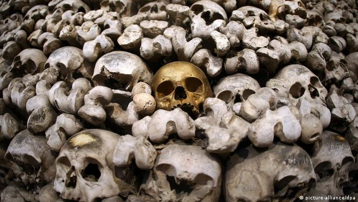 Mortal remians, skulls and bones are piled on top of each other in an ossuary in Oppenheim