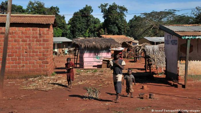 Residents, who had found refuge in a nearby forest during clashes, go about their daily chores on October 8, 2013 after returning to Bangassou. The Central Africa Republic has been shaken by a recent increase in clashes between ex-rebels of the Seleka coalition that led the coup, who are Muslim, and local self-defense groups formed by rural residents who are Christian, in common with around 80 percent of the population. The poor but mineral-rich nation was plunged into chaos when a coalition of rebels and armed movements ousted longtime president Bozize and took the capital Bangui in March. AFP PHOTO / ISSOUF SANOGO (Photo credit should read ISSOUF SANOGO/AFP/Getty Images)