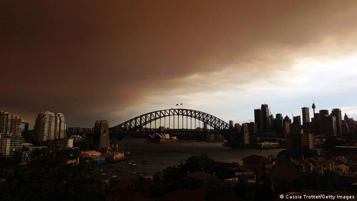 GettyImages 185026579 SYDNEY, AUSTRALIA - OCTOBER 17: (EDITORS NOTE: Image was created with a smartphone.) A general view of the Sydney CBD shrouded in smoke haze is seen on October 17, 2013 in Sydney, Australia. Sydney is shrouded in a haze of smoke as brushfires rage in the western Sydney suburbs of Springwood, Winmalee and Lithgow. (Photo by Cassie Trotter/Getty Images)