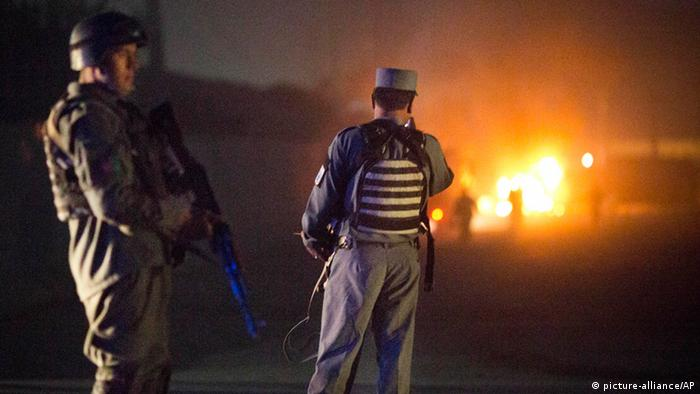 Afghan police secure the area after a car bomb detonated outside an ISAF civilian personnel compound in Kabul, Afghanistan, Friday, Oct 18, 2013. Police said the assault started at dusk when a car exploded near the gate of a compound, housing contractors from various countries, European diplomatic personnel and United Nations employees. (AP Photo/Anja Niedringhaus)