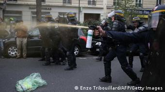 Anti riot police officers fire tear gas as high school students demonstrate in Paris, on October 18, 2013, in protest against the deportation of foreign pupils following the high-profile eviction of a 15-year-old Roma girl. Leonarda Dibrani (Photo: KENZO TRIBOUILLARD/AFP/Getty Images)