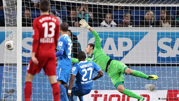 SINSHEIM, GERMANY - OCTOBER 18: Stefan Kiessling of Leverkusen scores his team's second goal against goalkeeper Koen Casteeln of Hoffenheim during the Bundesliga match between 1899 Hoffenheim and Bayer Leverkusen at Rhein-Neckar Arena on October 18, 2013 in Sinsheim, Germany. (Photo by Simon Hofmann/Bongarts/Getty Images)