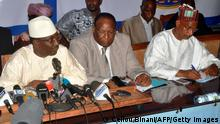Opposition leaders (From L) UFR's Sydia Toure, PEDN's Lansana Kouyate and UFDG' Cellou Dalien Diallo give a press conference on October 4, 2013 in Conakry to denounce electoral frauds as the country is waiting for the results of last September 28 legislative election. AFP PHOTO / CELLOU BINANI (Photo credit should read CELLOU BINANI/AFP/Getty Images)