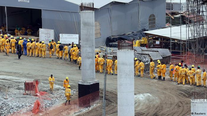 Laborers line up at the Guarulhos Airport construction site, Sao Paulo, September 25 2013. Earlier that month Brazil's labor ministry conducted operations to rescue 111 workers from 'slave-like' conditions on the site (Photo: Paulo Whitaker)
