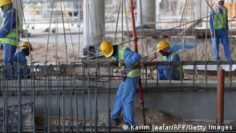 Migrant labourers work on a construction site on October 3, 2013 in Doha in Qatar. Qatar, the 2022 World Cup host is under fire over claims of using forced labour. Photo: KARIM JAAFAR/AFP/Getty Images