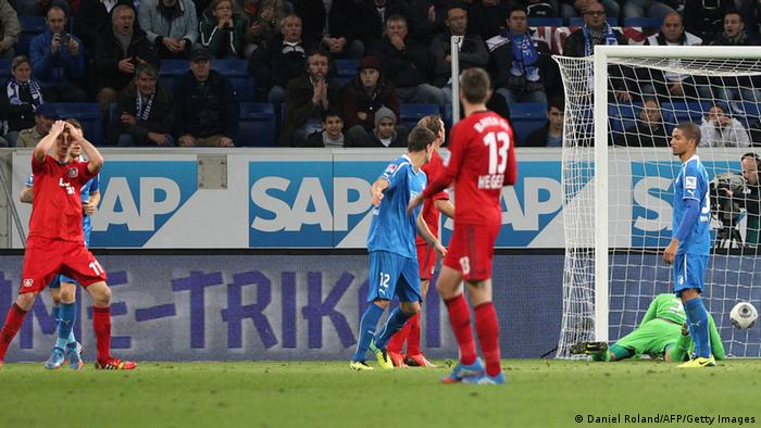 Leverkusen's Stefan Kiessling (L) reacts after scoring the 2-0 during the German first division Bundesliga football match TSG 1899 Hoffenheim vs Bayer 04 Leverkusen in Sinsheim, Germany, on October 18, 2013. AFP PHOTO / DANIEL ROLAND DFL RULES TO LIMIT THE ONLINE USAGE DURING MATCH TIME TO 15 PICTURES PER MATCH. FOR FURTHER QUERIES PLEASE CONTACT DFL DIRECTLY AT + 49 69 650050. (Photo credit should read DANIEL ROLAND/AFP/Getty Images)