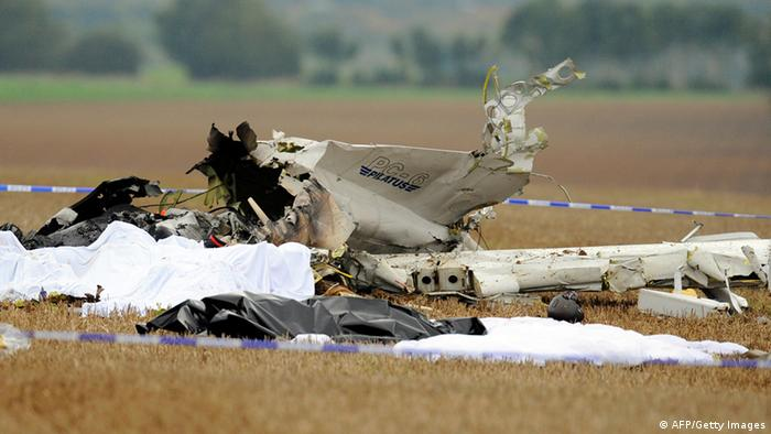 A picture taken on October 19, 2013 shows debris at a site where a plane carrying 10 parachutists crashed shortly after takeoff near the village of Marchovelette, 10 kilometres (six miles) from the southern city of Namur, killing all the passengers on board, the local mayor said. The plane took off from Temploux aerodrome with 10 parachutists and probably a pilot on board and crashed around 10 minutes later in a field. All those on board are unfortunately dead. The toll is 10 or 11 victims, the mayor of Fernelmont, Jean-Claude Nihoul, told AFP. AFP PHOTO / BELGA / JOHN THYS ***Belgium Out*** (Photo credit should read JOHN THYS/AFP/Getty Images)