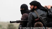 Fighters of the jihadist group Al-Nusra Front stand on the top of a pick-up mounted with a machine gun during fightings against the regime forces on April 4, 2013 in the Syrian village of Aziza, on the southern outskirts of Aleppo. AFP PHOTO GUILLAUME BRIQUET (Photo credit should read Guillaume Briquet/AFP/Getty Images)