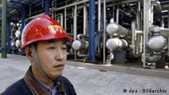 A worker at an oil refinery in northeast China's Jilin City