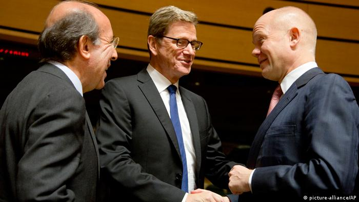 British Foreign Secretary William Hague, right, speaks with German Foreign Minister Guido Westerwelle, center, and Spanish Foreign Minister Jose Manuel Garcia-Margallo, left, during a roundtable meeting of EU foreign ministers at the EU Council building in Luxembourg (Photo: AP Photo/Virginia Mayo)