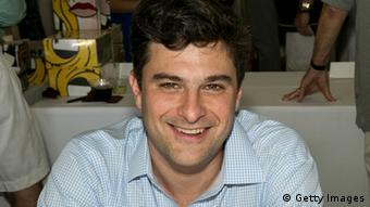 A dark-haired man smiles at the camera. Photo: Matthew Peyton