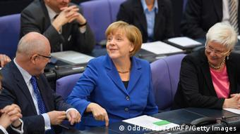 German Chancellor Angela Merkel (C) of the Christian Democratic Union (CDU) has taken seat between the Christian Social Union's (CDU) parliamentary group leader Gerda Hasselfeldt (R) and CDU/CSU parliamentary group leader Volker Kauder to attend the constitutional meeting at the Bundestag (lower house of parliament) on October 22, 2013 in Berlin. AFP PHOTO / ODD ANDERSEN (Photo credit should read ODD ANDERSEN/AFP/Getty Images)