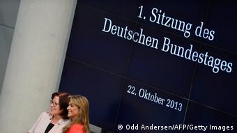 Delegates pose in front of a sceen reading 'First session of the German Bundestag' ODD ANDERSEN/AFP/Getty Images)