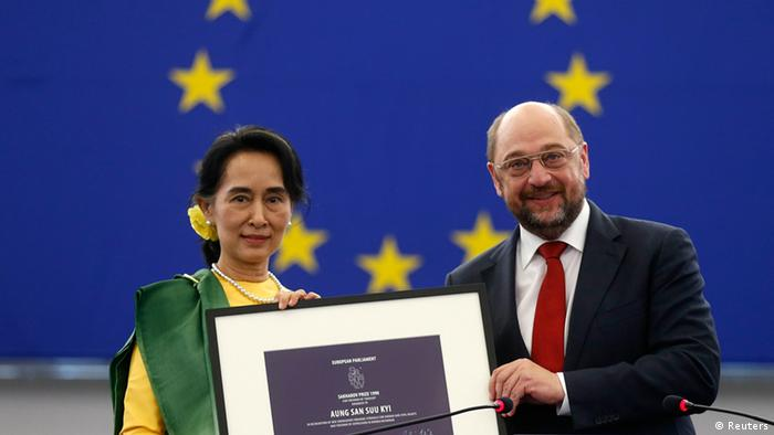 Myanmar pro-democracy leader Aung San Suu Kyi (L) holds her 1990 Sakharov Prize, besides European Parliament President Martin Schulz during an award ceremony in Strasbourg, October 22, 2013. The European Parliament awarded its top human rights prize in 1990 to Aung San Suu Kyi, who was then not allowed to leave her country to attend the ceremony. REUTERS/Vincent Kessler (FRANCE - Tags: POLITICS TPX IMAGES OF THE DAY)