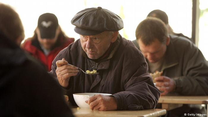 BERLIN - OCTOBER 18: People eat soup at a soup kitchen at a Fransiscan Monastery October 18, 2006 in Berlin, Germany. Politicians have launched debates over the growing number of poor people in Germany, after a recent study showed that four percent of west Germans and 20 percent of east Germans fall into a classification of 'underclass,' characterized by poverty and limited education. (Photo by Sean Gallup/Getty Images)