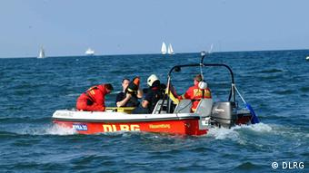 A DLRG boat brings lifeguards out into the ocean