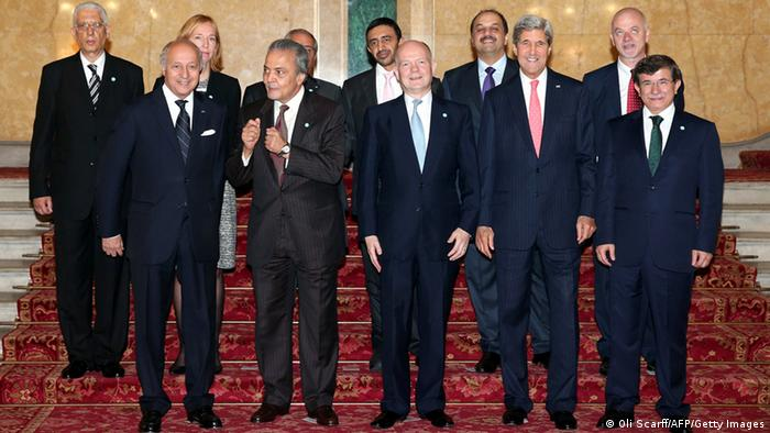From (L-R front row) Foreign Ministers of France Laurent Fabius, Saudi Prince Saud al-Faisal, Britain William Hague, US John Kerry and Turkey Ahmet Davutoglu, (Back L-R) Egyptian deputy foreign minister Egypt Hamdi Sanad Loza, German State Secretary of the Federal Foreign Office Emily Haber, Jordan's Foreign Minister Nasser Judeh, UAE Foreign Minister Sheikh Abdullah Bin Zayed al-Nahyan, Qatar's Foreign Minister Khalid bin Mohamed al-Attiyah and Italy's deputy foreign minister Lapo Pistelli pose for a group photograph before holding the London 11 meeting from the Friends of Syria Core Group at Lancaster House in London on October 22, 2013. . Arab and Western powers met in London Tuesday to push Syrian oppsition leaders to attend talks in Geneva next month, but President Bashar al-Assad poured cold water on hopes of any peace deal. AFP PHOTO/OLI SCRAFF (Photo credit should read OLI SCARFF/AFP/Getty Images)