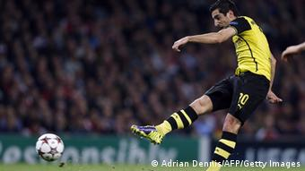 GettyImages 185582090 Borussia Dortmund's Armenian midfielder Henrikh Mkhitaryan scores the opening goal of the UEFA Champions League Group F football match between Arsenal and Borussia Dortmund at the Emirates Stadium, north London, on October 22, 2013. AFP PHOTO/ADRIAN DENNIS (Photo credit should read ADRIAN DENNIS/AFP/Getty Images)