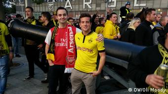 Arsenal and Dortmund fans in front of the Emirates Stadium