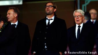 Borussia Dortmund manager Jurgen Klopp (C) looks on from the stands before their Champions League soccer match against Arsenal at the Emirates stadium in London October 22, 2013. REUTERS/Eddie Keogh (BRITAIN - Tags: SPORT SOCCER)