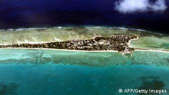 Vacant land is at a premium on Tarawa atoll, capital of the vast archipelago nation of Kiribati 11 September 2001, which has offered to accept some of 670 mainly Afghan refugees bound for neighbouring Nauru. Nauru is largely unprepared to accommodate some 521 refugees currently onboard the Australian troop carrier 'Manoora'. Another 150 refugees onboard will be flown directly to New Zealand. AFP PHOTO/Torsten BLACKWOOD (Photo credit should read TORSTEN BLACKWOOD/AFP/Getty Images)