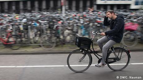 A man on a bike in Amsterdam (photo: Carl Nasman)