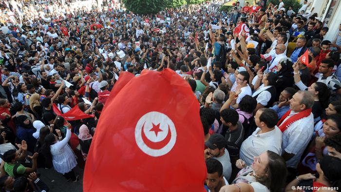 Tunisian opposition activists shout slogans during a demonstration in Tunis (FETHI BELAID/AFP/Getty Images)