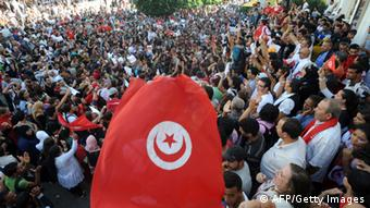 Tunisian opposition activists shout slogans during a demonstration in Tunis' central Habib Bourguiba Avenue on October 23, 2013 demanding the resignation of Tunisia's Islamist-led government, ahead of a national dialogue aimed at ending months of political deadlock. The Habib Bourguiba Avenue was the epicentre of the January 2011 revolution that ousted former dictator Zine El Abidine Ben Ali. AFP PHOTO/ FETHI BELAID (Photo credit should read FETHI BELAID/AFP/Getty Images)