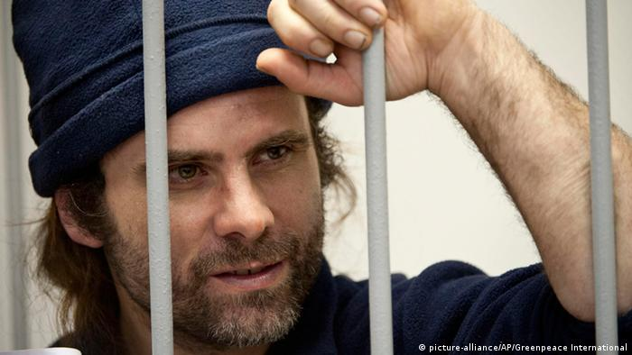 In this photo released by Greenpeace International one of the activists Iain Rogers from the United Kingdom is in a defendants' cage at a Murmansk district court, in Murmansk, Russia, Tuesday, Oct. 22, 2013. AP Photo/Greenpeace International, Dmitri Sharomov