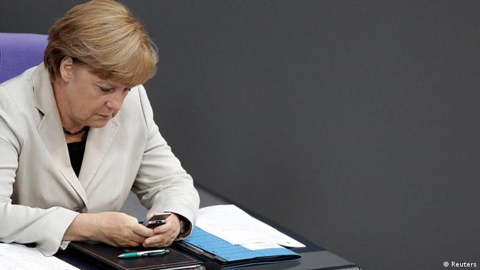 Angela Merkel on her phone