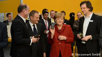 """Foto: Secusmart GmbH.*** Merkel and Quelle"