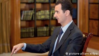 Syrian President Bashar al-Assad speaking during a television interview EPA/SANA HANDOUT