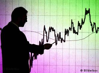 Man in front of a graph