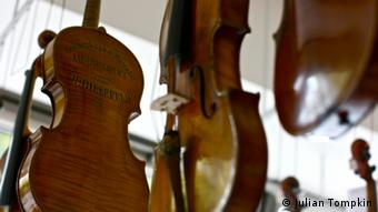 Violins hanging up in the workshop of Kevin Gentges (photo: Julian Tompkin)