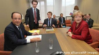 German Chancellor Angela Merkel, right, and French President Francois Hollande, left, participate in a bilateral meeting on the sidelines of an EU summit on Thursday, Oct. 24, 2013. A two-day summit meeting of EU leaders is likely to be diverted from its official agenda, economic recovery and migration, after German Chancellor Angela Merkel complained to U.S. President Barack Obama that U.S. intelligence may have monitored her mobile phone. (AP Photo/Michel Euler, Pool)