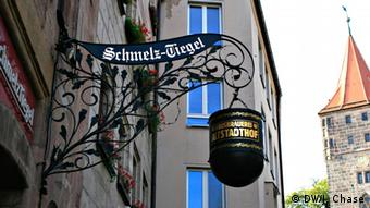 The wrought-iron sign outside the Schmelz-Tiegel tavern
