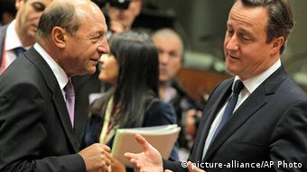British Prime Minister David Cameron, right, speaks with Romanian President Traian Basescu during a round table meeting at an EU summit in Brussels. (AP Photo/Yves Logghe)