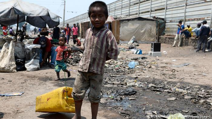 A young boy in Madagascar drags an empty jerry can