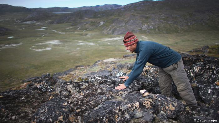Jason Briner, with the University of Buffalo, Department of Geology, looks for the right spot to gather samples of granite to research the age of the local glacial retreat on July 24, 2013 in Ilulissat, Greenland. As the sea levels around the globe rise, researchers affilitated with the National Science Foundation and other organizations are studying the phenomena of the melting glaciers and its long-term ramifications. The warmer temperatures that have had an effect on the glaciers in Greenland also have altered the ways in which the local populace farm, fish, hunt and even travel across land. In recent years, sea level rise in places such as Miami Beach has led to increased street flooding and prompted leaders such as New York City Mayor Michael Bloomberg to propose a $19.5 billion plan to boost the citys capacity to withstand future extreme weather events by, among other things, devising mechanisms to withstand flooding. (Photo by Joe Raedle/Getty Images)
