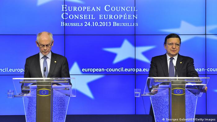 European Union president Herman Van Rompuy (L) and European Commission president Jose Manuel Barroso give a press conference early on October 25, 2013 in Brussels. France and Germany pushed today for Washington to agree new rules on espionage after damaging revelations the United States tapped German Chancellor Angela Merkel's mobile phone and spied on other allies. Paris and Berlin will 'seek bilateral talks with the US' to reach an understanding by year's end on the conduct of intelligence gathering among allies, EU President Herman Van Rompuy told reporters after a first day of EU summit talks. AFP PHOTO / GEORGES GOBET (Photo credit should read GEORGES GOBET/AFP/Getty Images)