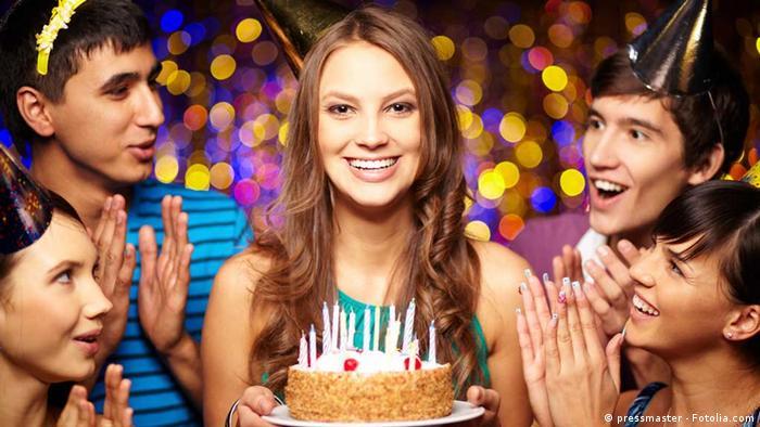 Birthday celebrations with cake and birthday hats