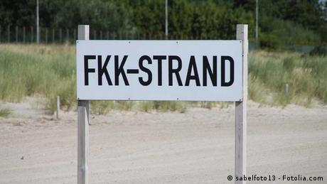 Sign reading FKK Strand, which means FKK beach, and indicates that the free body cuture is celebrated at this beach and people will sunbath and swim naked here