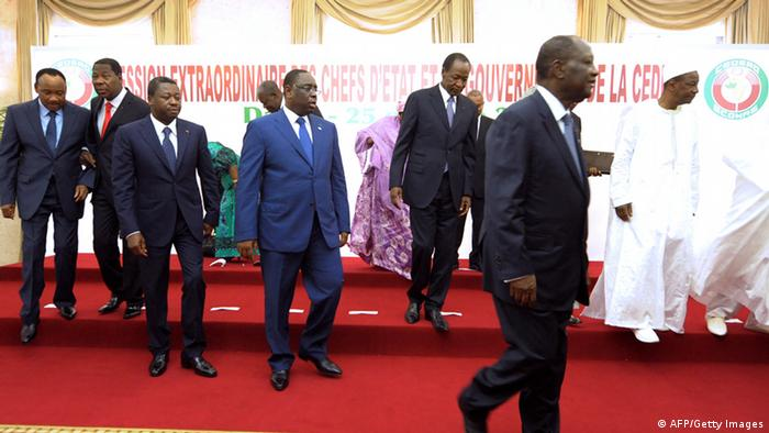 (From L) Niger's president Mahamadou Issoufou, Benin's president Thomas Boni Yayi, Togo's Faure Gnassingbe, Senegal's Macky Sall, Burkina Faso's Blaise Compaore, Ivory Coast Alassane Ouattara and Guinea-Bissau's interim President Manuel Serifo Nhamadjo, leave after a family picture during a 15-nation west African bloc ECOWAS special summit focused on moving the region towards a common market and a single currency by 2020, on October 25, 2013 in Dakar. SEYLLOU/AFP/Getty Images