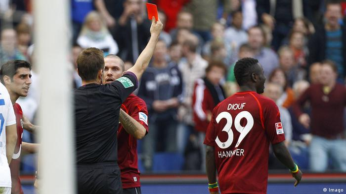 Mame Biram Diouf is handed his second yellow card within one first-half minute in Hannover's 4-1 Bundesliga loss to Hoffenheim on Saturday. Photo: imago