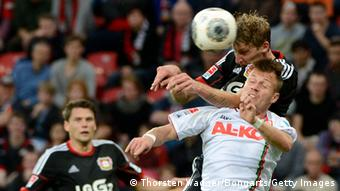 LEVERKUSEN, GERMANY - OCTOBER 26: Stefan Kiessling (L) of Leverkusen battles for the ball with Ronny Philip (R) of Augsburg during the Bundesliga match between Bayer 04 Leverkusen and FC Augsburg at BayArena on October 26, 2013 in Leverkusen, Germany. (Photo by Thorsten Wagner/Bongarts/Getty Images)