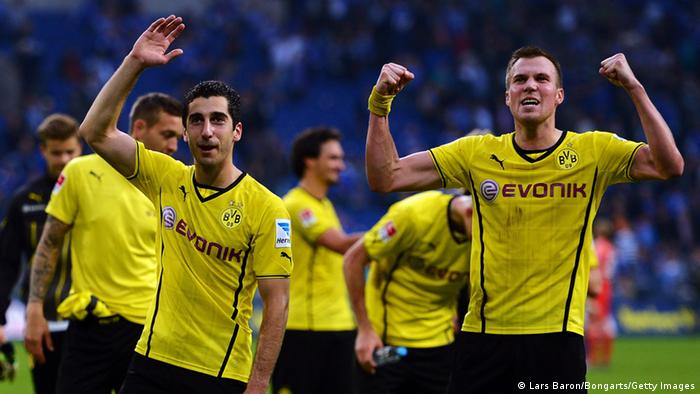 Henrikh Mkhitaryan and Kevin Grosskreutz of Dortmund celebrate after winning the Bundesliga match between FC Schalke 04 and Borussia Dortmund at Veltins-Arena on October 26, 2013 in Gelsenkirchen, Germany. (Photo by Lars Baron/Bongarts/Getty Images)