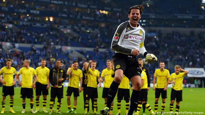 Roman Weidenfeller of Dortmund celebrates after winning the Bundesliga match between FC Schalke 04 and Borussia Dortmund at Veltins-Arena on October 26, 2013 in Gelsenkirchen. Photo by Lars Baron/Bongarts/Getty Images