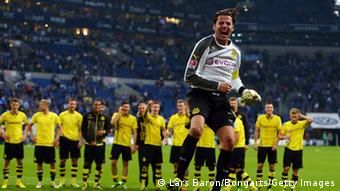 Roman Weidenfeller of Dortmund celebrates after winning the Bundesliga match between FC Schalke 04 and Borussia Dortmund at Veltins-Arena on October 26, 2013 in Gelsenkirchen, Germany. Photo: Getty