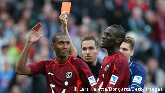 Referee Tobias Stieler shows the red card to Marcelo (L) of Hannover during the Bundesliga match between Hannover 96 and 1899 Hoffenheim at HDI Arena on October 26, 2013 in Hanover, Germany. Photo: Lars Kaletta/Bongarts/Getty Images